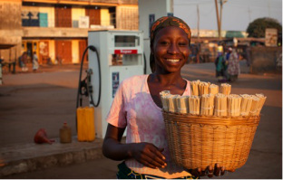 Young-Nigerian-African-Woman-Selling-Chewing-Sticks